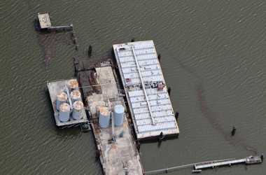 Oil leaks from an oil storage and transfer facility in Barataria Bay after Hurricane Isaac in 2012. (Photo by Jonathan Henderson, Gulf Restoration Network; flight provided by SouthWings.org)