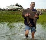 Jim Elorriaga found his dog, Woody, among the debris of Hurricane Katrina Slidell, La. (Photo by David Grunfeld, Nola.com | The Times-Picayune)