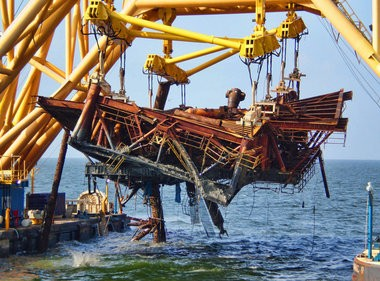 "Versabar Inc.'s ""Bottom Feeder"" vessel removes a toppled platform from the Gulf of Mexico in July 2008. The company designed the Bottom Feeder after Hurricane Katrina in order to recover platforms from the ocean floor in a single piece. Recovering offshore structures remains a large portion of Versabar's work 10 years after Katrina. (Versabar Inc.)"