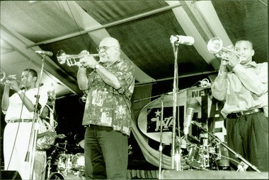 Clyde Kerr, center, with Christian Scott, left, and Troy 'Trombone Shorty' Andrews on May 5, 2000 at the Jazz WWOZ Jazz Tent at the New Orleans Jazz and Heritage Festival. Photo Eric Waters