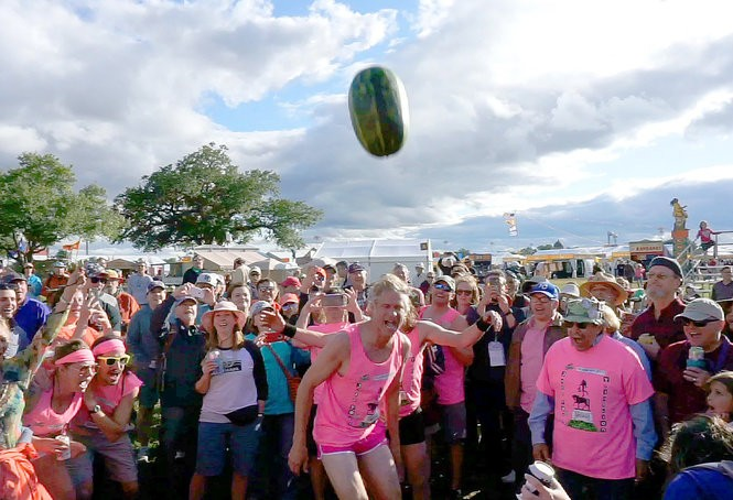 Members of the unofficial Jazz Fest Triathlon participate in their annual Watermelon Sacrifice on May 4, 2017.