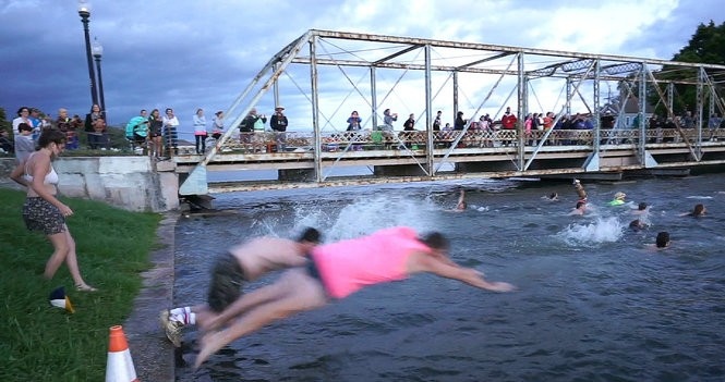 Jazz Fest Triathlon competitors leap into Bayou Saint John on May 4, 2017, for the swimming portion of the day's events.