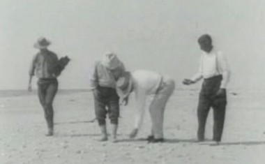 Teddy Roosevelt, second from left, explores the beach during a visit to the Louisiana coast in 1915, as seen in the silent film 'Theodore Roosevelt Friend of the Birds.' (Screengrab)