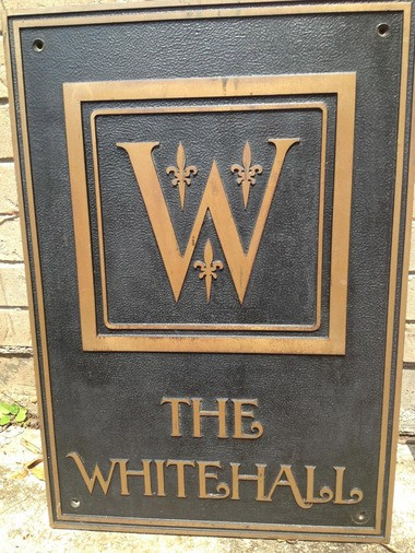 An original sign for the Whitehall Hotel in Houston, found in 2001 in the building's basement. The font and logo used are perfect matches for a pair of hurricane glasses recently uncovered by a man in Kansas. (Photo via Southerly Hotels)