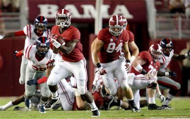 Alabama running back T.J. Yeldon (4) carried the load for the Crimson Tide running game this season. (AP Photo/Tuscaloosa News, Dusty Compton)
