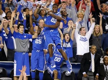 Kentucky forward Alex Poythress (22) reacts after a three-point basket during the second half of an NCAA Final Four tournament college basketball semifinal game against Wisconsin Saturday, April 5, 2014, in Arlington, Texas. Kentucky won 74-73.