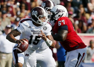 Mississippi State quarterback Dak Prescott (15) scrambles away from pressure against the South Alabama defense last week in a 35-3 Bulldogs' victory.
