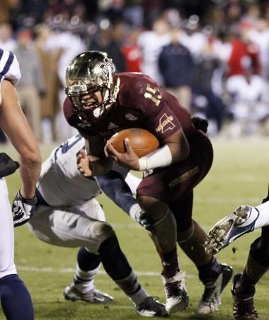 Mississippi State quarterback Dak Prescott (15) scores the game-winning touchdown in overtime against Ole Miss last Nov. 28.