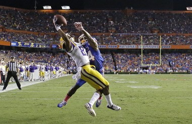 LSU wide receiver Travin Dural, front, catches a pass in front of Florida defensive back Brian Poole for an 11-yard touchdown in Gainesville, Fla., Saturday, Oct. 11, 2014.