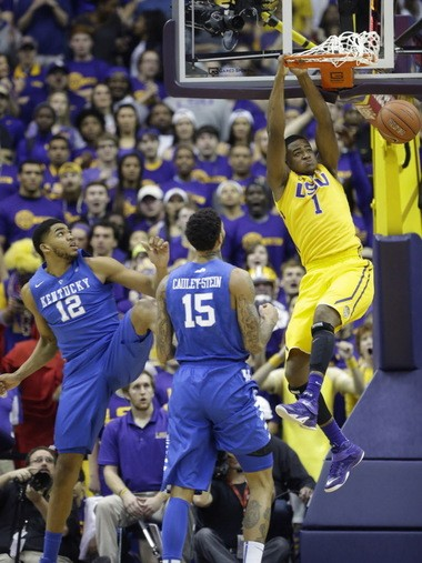 Former LSU forward Jarell Martin (1) slam-dunks over Kentucky forwards Karl-Anthony Towns (12) and Willie Cauley-Stein (15) last season. All three were taken in the 1st round of the 2015 NBA Draft.