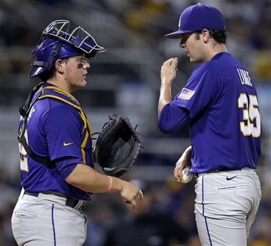 LSU pitcher Alex Lange (35) talks with catcher Kade Scivicque (22) in the second inning of a game against UNC-Wilmington at the Baton Rouge Regional of the NCAA college baseball tournament in Baton Rouge, La., Saturday, May 30, 2015. (AP Photo/Gerald Herbert)