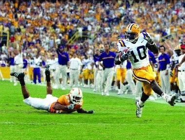 LSU running back Joseph Addai outruns Tennessee's Antwan Stewart as he scores a touchdown in the first quarter of their game in Baton Rouge on Monday Sept. 26, 2005.