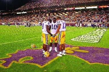 Louisiana State players, from left, Ronnie Prude, Joseph Addai and Bennie Brazell pray on the map of Louisiana after defeating Arizona State 35-31 Saturday, Sept. 10 2005, in Tempe, Ariz. (AP Photo/Darryl Webb)