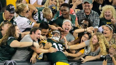 Green Bay Packers wide receiver Myles White (19) does the Lambeau Leap with Packers fans after scoring a TD in the fourth quarter against the Saints during the final preseason game at Lambeau Field in Green Bay, Wi., Thursday, September 3, 2015. (Photo by David Grunfeld, NOLA.com | The Times-Picayune)
