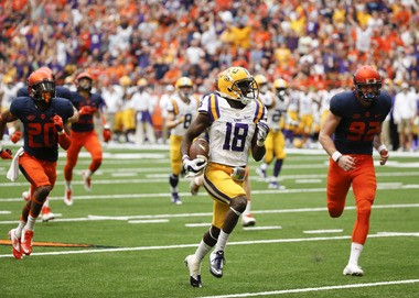 LSU 's Tre'Davious White (18) beats Syracuse punter Riley Dixon (92) and other defenders as he returns a punt for a touchdown during the second half of an NCAA college football game on Saturday, Sept. 26, 2015, in Syracuse, N.Y. (AP Photo/Mike Groll)