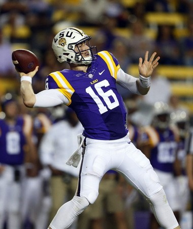 Empty seats can be seen behind LSU quarterback Danny Etling as he throws a pass for a touchdown during the second half LSU's 45-10 win against Southern Miss.