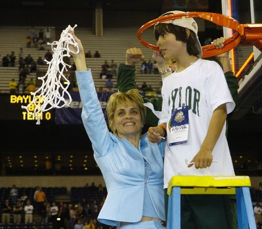 Baylor coach Kim Mulkey with a then 10-year-old Kramer, cutting down the net after winning the NCAA Div. I Women's Final Four Championship Game in the RCA Dome in Indianapolis, Ind. on Tuesday, April 5, 2005.