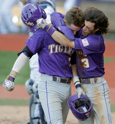Kramer Robertson (3) hugs Greg Deichmann (7) after Deichmann's home run during the 2016 NCAA Baton Rouge Regionals at Alex Box Stadium in Baton Rouge on Tuesday, June 7, 2016. Robertson has been known to wear his emotions on his sleeve on the diamond.