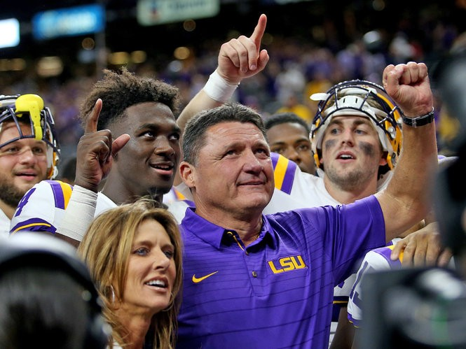 1f43434c4 (LSU Tigers head coach Ed Orgeron celebrates with the team after the Texas  Kickoff game between the BYU Cougars and LSU Tigers at the Superdome on  Saturday, ...