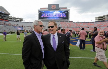 LSU coach Les Miles and Tigers' athletic director Joe Alleva chat before LSU's eventual 18-13 loss at Auburn last September 24. Alleva fired Miles the next day.