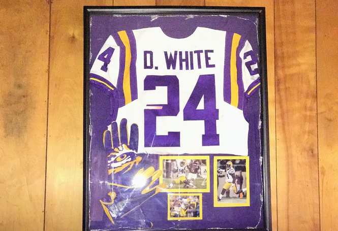 A jersey from Devin White's freshman year hangs in the living room of his grandmother Doris White's house in Cullen, La. (Photo by Andrew Lopez, NOLA.com | The Times-Picayune)