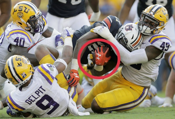LSU linebacker Arden Key (49) played with a cast on his right hand to protect his broken pinky when the Tigers played Auburn on Oct. 14