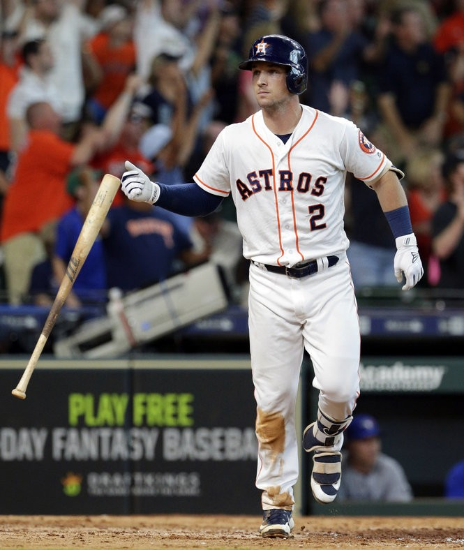 Houston Astros' Alex Bregman (2) flips his bat after his two run home run to win the game during the ninth inning of a baseball game against the Toronto Blue Jays Wednesday, June 27, 2018, in Houston. Bregman was named to his first All-Star Game on Sunday.