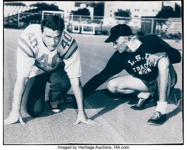 This picture of Billy Cannon being coached by LSU track coach Al Moreau has been used as proof of authenticity in auctioning Cannon's used game jersey.