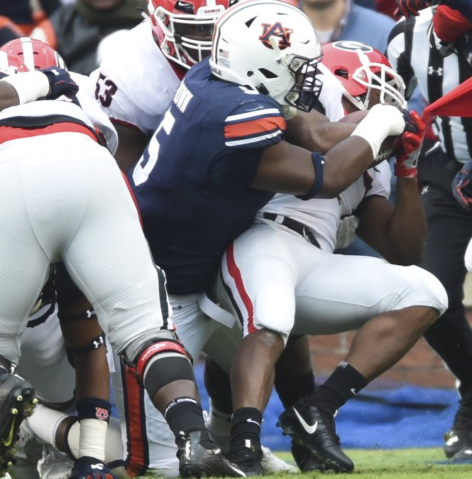 Auburn defensive lineman Derrick Brown (5) wraps up Georgia tailback Nick Chubb (27) during the first half Saturday, Nov. 11, 2017, at Jordan-Hare Stadium in Auburn, Ala. (Julie Bennett/jbennett@al.com) AP