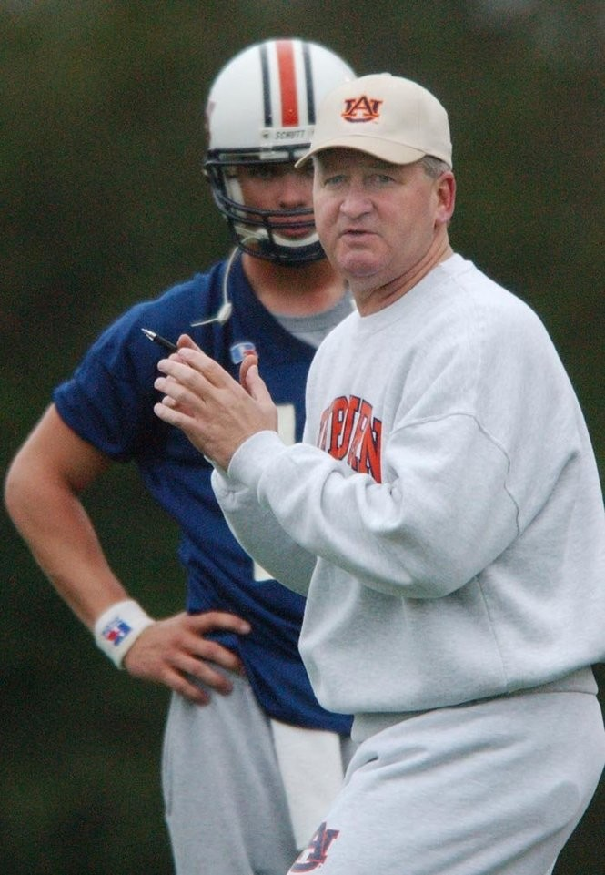 Auburn football players had their first spring football practice Tuesday afternoon. New QB coach Steve Ensminger demonstrates for hi QBs as #13 Josh Sullivan looks on. News staff/Hal Yeager reporter/Goldberg bn