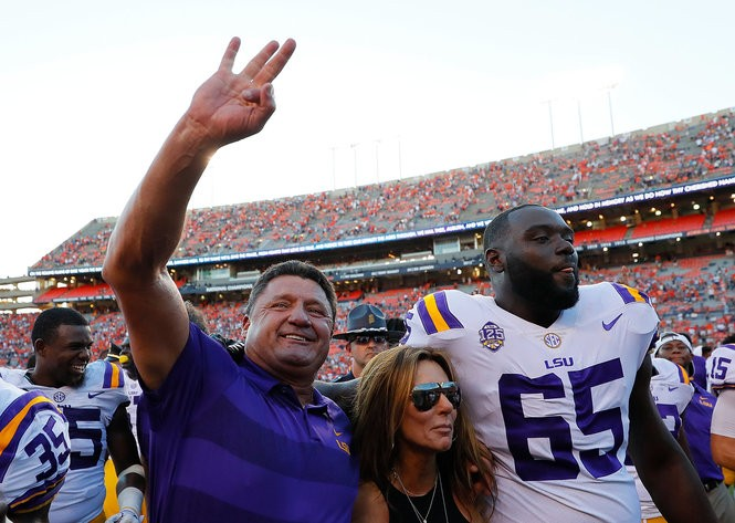 AUBURN, AL - SEPTEMBER 15: Head coach Ed Orgeron of the LSU Tigers celebrates with his wife Kelly Orgeron and Jakori Savage #65 after their 22-21 win over the Auburn Tigers at Jordan-Hare Stadium on September 15, 2018 in Auburn, Alabama. (Photo by Kevin C. Cox/Getty Images) Getty Images