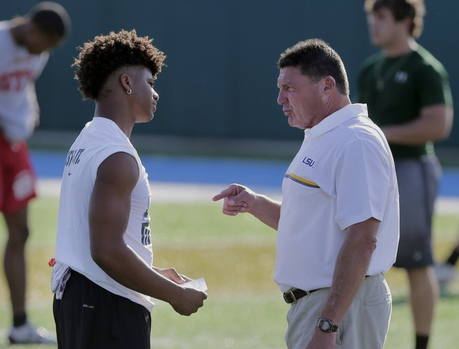 LSU coach Ed Orgeron talks with a football player during the Tulane/LSU football camp at Tulane's Yulman Stadium in New Orleans on Friday, June 16, 2017. The camp gave some of the top prospects an opportunity to showcase their skills in front of coaching staffs from both teams. (Photo by Brett Duke, Nola.com   The Times-Picayune)