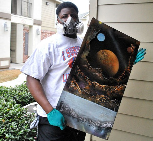 University Lab offensive lineman, and LSU commitment Garrett Brumfield poses with a painting he finished Jan. 27, 2014. (Amos Morale, NOLA.com | The Times-Picayune) NOLA.com | The Times-Picayune