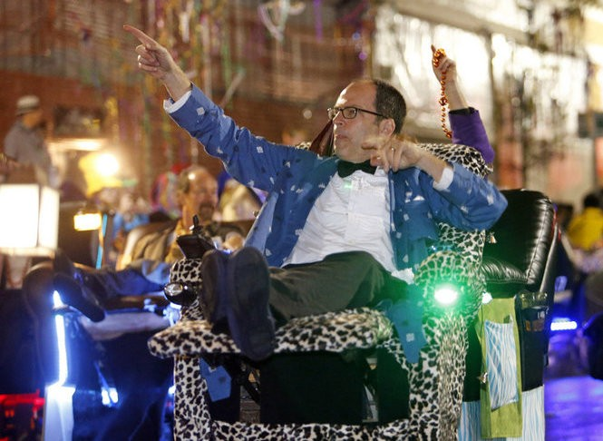 Members of the Laissez Boys Social Aid & Leisure Club ride in their electro-powered recliners during the Krewe of Orpheus parade in New Orleans, Monday, February 11, 2013. (Photo by Brett Duke, Nola.com | The Times-Picayune)