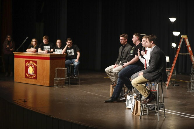 Hillsboro High School students, left to right, Shelby Johnson, Dakota Klein, Callyan Lacio and Dylan Wiens ask questions of the candidates for Kansas governor. (Photo by Jeff Tuttle for The Washington Post)