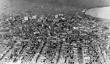 Downtown New Orleans, 1919, looking east. The Mississippi River flows toward the upper right; Lee Circle and St. Charles Avenue can be seen toward the bottom right.
