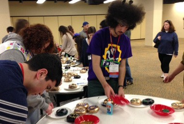 Jonah Linder, 17, decorates a bagel along with other United Synagogue Youth conventioneers at the Hilton New Orleans Riverside hotel on Dec. 25, 2013. (Ben Myers NOLA.com | The Times-Picayune).