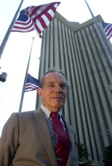 World Trade Center Association founder Paul Fabry poses defiantly in front of the WTC tower just days September 11, 2001.