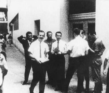 Lee Harvey Oswald distributing Fair Play for Cuba leaflets outside the original ITM, August 16, 1963.