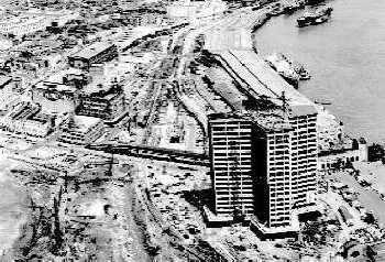 World Trade Center tower under construction, showing undeveloped surroundings in the 1960s.