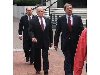 Former North Shore District Attorney Walter Reed, center, who was convicted on federal corruption charges in 2016, walks to the U.S. 5th Circuit Court of Appeals in New Orleans on Tuesday, May 1, 2018, along with son, Steven Reed, left, and brother Richard Reed. Steven Reed also was convicted in the case, which is being appealed.