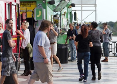 Customers peruse the offerings of a food truck roundup at Spanish Plaza in New Orleans. (File photo)
