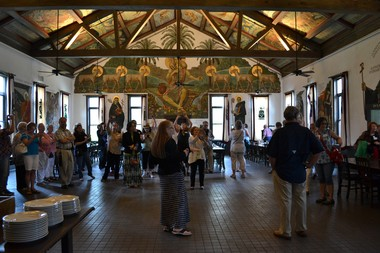 Jane Brown, center, gives a tour of the hand-painted murals by Dom Gregory de Wit in the Refectory, where the Abbey's monks dine in silence each day.