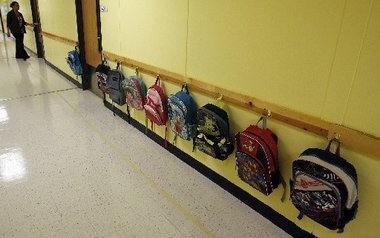Backpacks line the wall on the first day of school August 10, 2011, at Abramson, which switched is management after the Board of Elementary and Secondary Education revoked its contract with Abramson Science and Technology Charter School in eastern New Orleans.