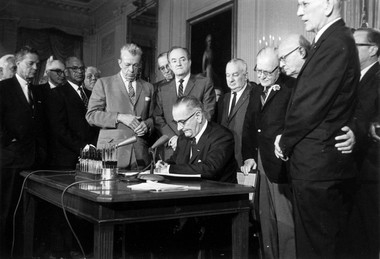 This July 2, 1964 file photo shows President Lyndon Baines Johnson signing the civil rights bill, in the East Room of the White House in Washington. Standing from left, are: Sen. Everett Dirksen, R-Ill; Rep. Clarence Brown, R-Ohio; Sen. Hubert Humphrey, D-Minn; Rep. Charles Halleck, R-Ind; Rep. William McCullough, R-Ohio; and Rep. Emanuel Celler, D-NY. Humphrey was instrumental in getting the act passed. (AP Photo, File)