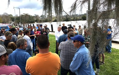 Crabbers from the New Orleans area gather Tuesday (Feb. 21, 2017) on the shore of Lake Pontchartrain in Mandeville to talk about the month-long ban on commercial crab fishing in Louisiana waters.