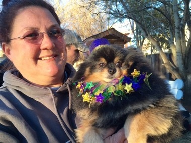 Lisa Gipson with Shorty, her rescued Pomeranian, enjoying Little Paws