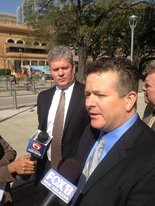 Attorney Patrick Hand, right, talks to reporters outside the district courthouse in Baton Rouge after a judge struck down the November results of the Crescent City Connection tolls extension referendum. At left is Mike Teachworth, who brought the suit as president of Stop the Tolls.