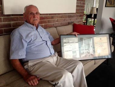 Retired architect T. Sellers Meric holds the award he and his business partner, Benedict Cimini, received in 1964 for their redesign of the New Orleans Lakefront Airport terminal. Renovations to restore it to its original depression-era art deco appearance have been completed. (photo by Richard Rainey, Nola.com The Times-Picayune)