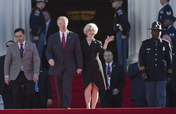 """In this Monday, Jan. 19, 2015 file photo, Alabama Gov. Robert Bentley and his wife, Dianne Bentley, walk down the Capitol steps during his inauguration for a second term, in Montgomery, Ala. Alabama's first lady on Friday. Aug. 28, 2015, filed for divorce from Gov. Robert Bentley, saying their 50-year marriage has suffered an """"irretrievable breakdown.""""(AP Photo/Brynn Anderson, File)"""